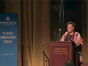 Rev. Vivian Nixon stands at the podium to deliver her Columbia 社区 Scholar lecture in Low Library